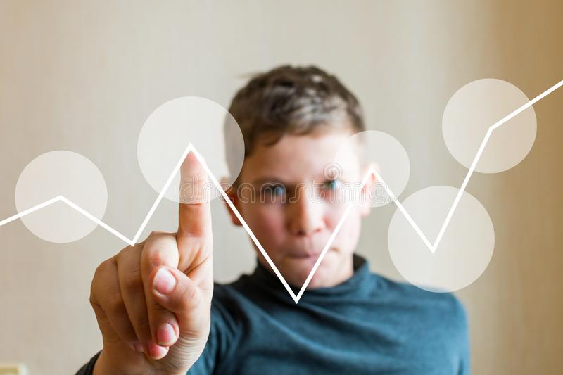 Teen boy shows his finger at an imaginary screen royalty free stock photography