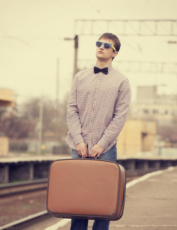 Teen at railways. Teen boy with suitcase at railways royalty free stock images
