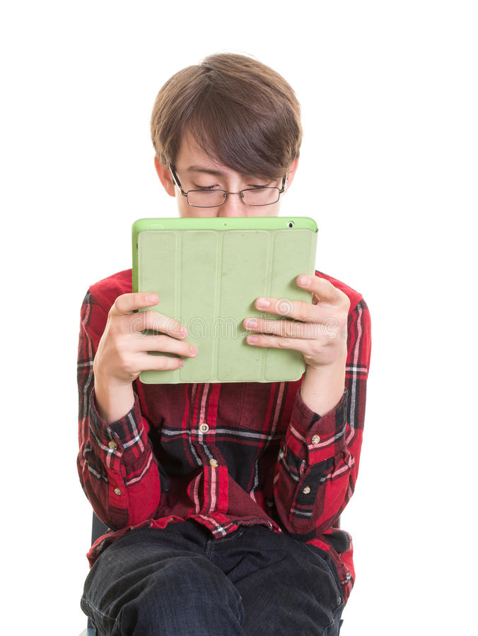 Teen boy with tablet computer stock image