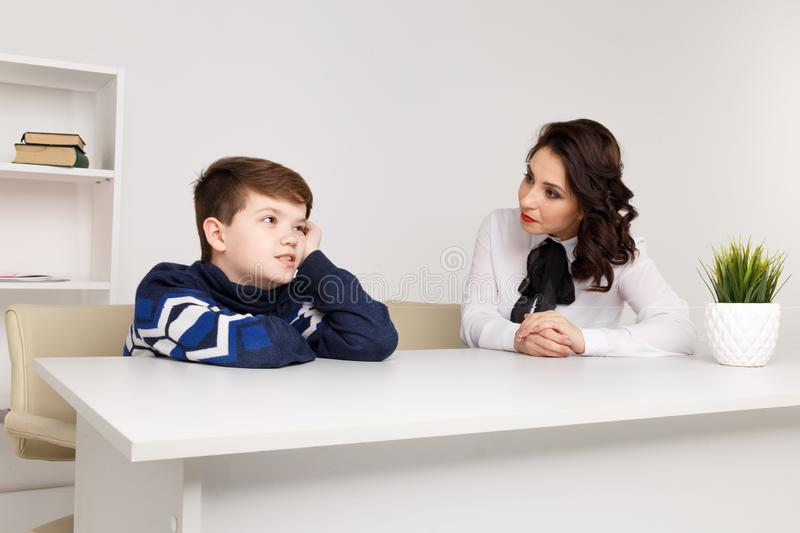 Teen boy talking to his therapist. Social worker and patient. Teen boy talking to his therapist. Social worker and patient royalty free stock photo