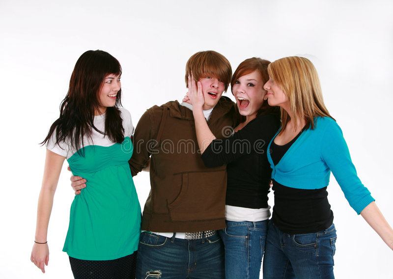 Teen boy with three girls royalty free stock photos