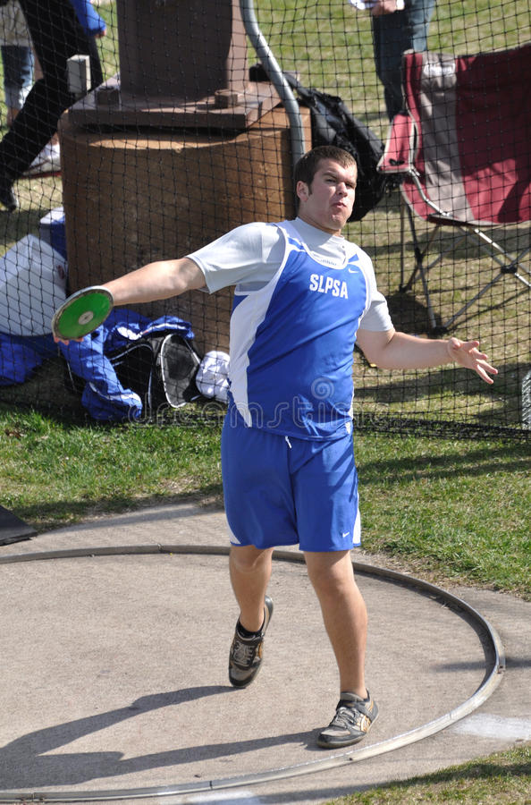 Download Teen Boy Throwing Discus At High School Track Meet Editorial Photo - Image: 19470701