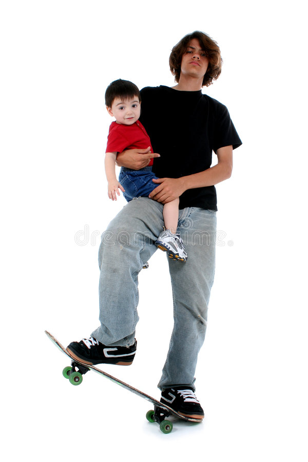 Teen Boy and Toddler Boy on Skateboard royalty free stock images