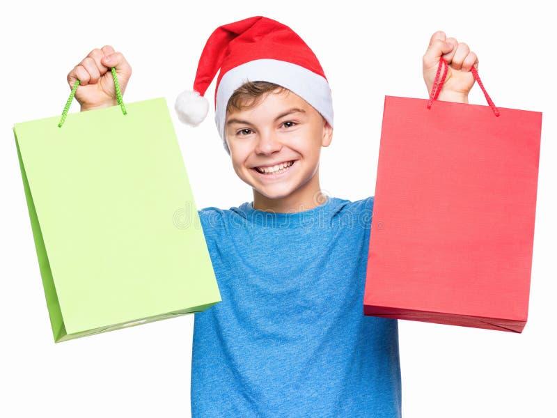 Teen boy wearing Santa Claus hat stock image