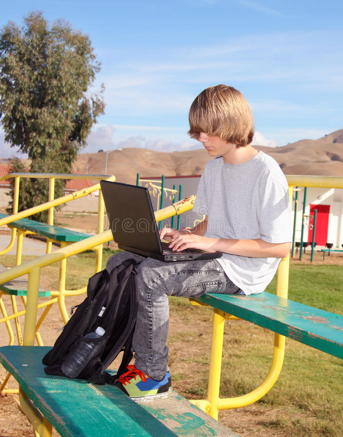 Download Teen Boy  Working On Laptop Stock Photo - Image: 16695972