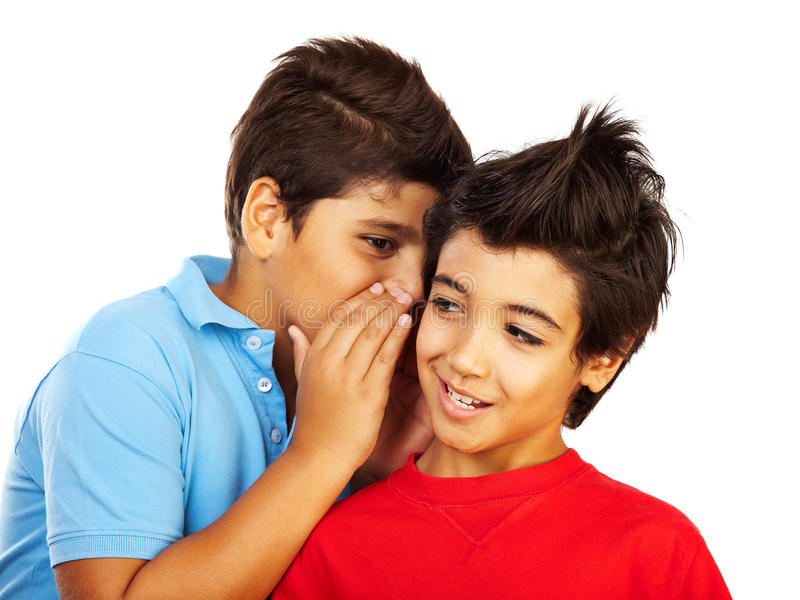 Teen boys gossip. Kids telling secrets, isolated on white background, best friends concept stock images
