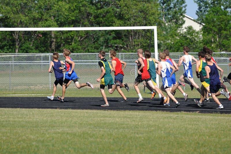 Teen Boys Running in Long Distance Track Meet Race