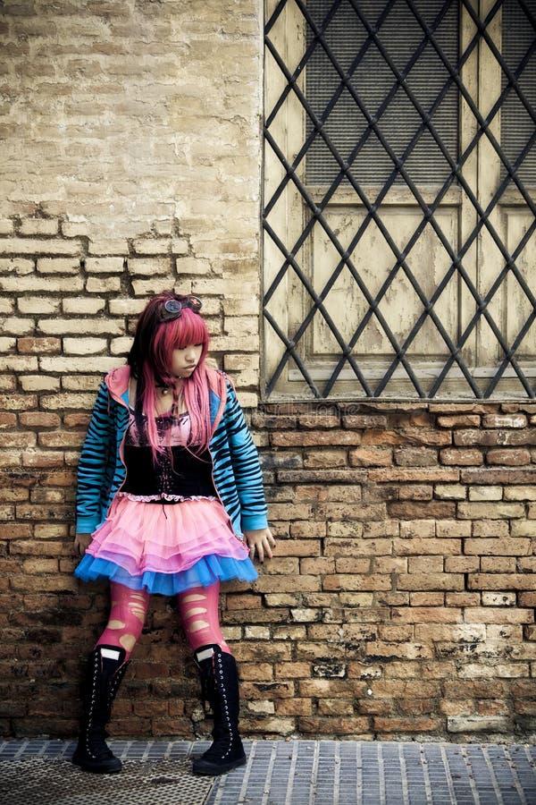Teen on brickwall. Teen wearing doll fashion style on brickwall stock photos