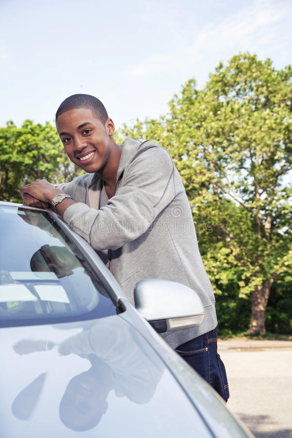 Teen with car stock photography