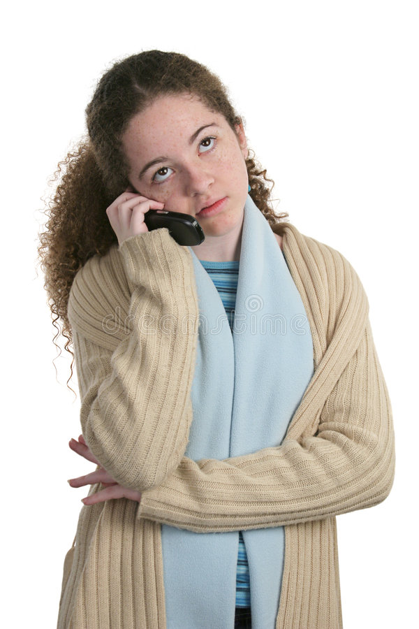 Teen Cell Phone - Bored. A cute teen girl talking on the cellphone, having a boring conversation. Isolated stock photography