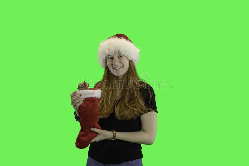 Teen with Christmas stocking green screen stock photos