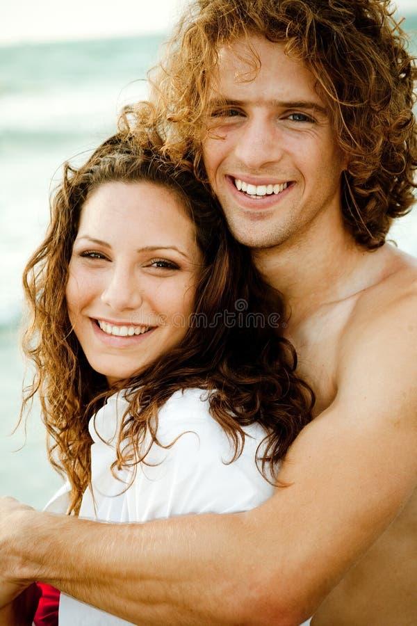 Teen couple embracing stock photo