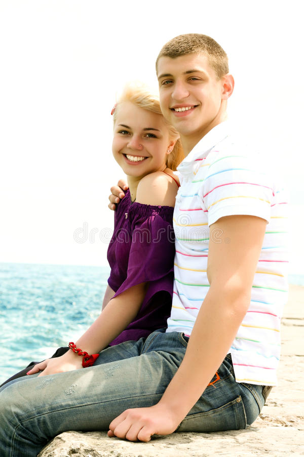 Teen Couple Embracing Stock Images