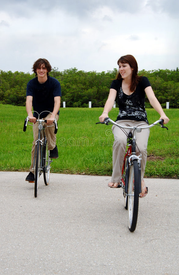 Download Teen couple riding bikes stock photo. Image of active - 5909312