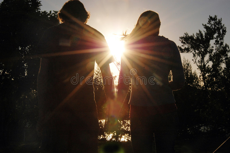 Teen couple silhouette royalty free stock photos
