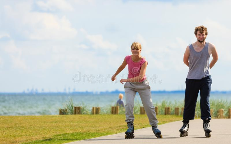 Teen couple together on skates royalty free stock photo