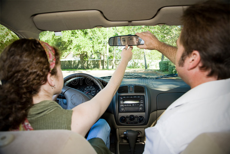 Teen Driver - Adjusting Mirror Stock Image
