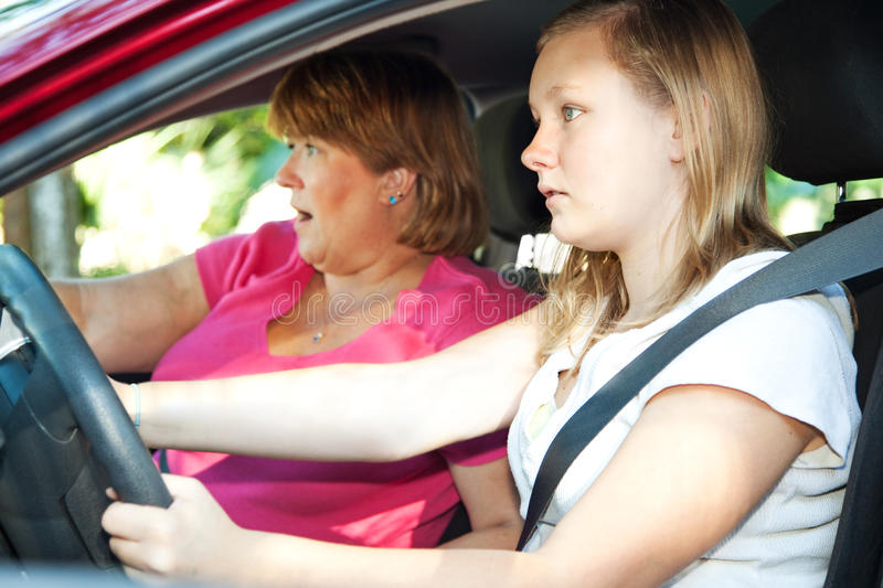 Teen Driver - Car Accident. Teenage driver and her mother about to have a car accident royalty free stock images