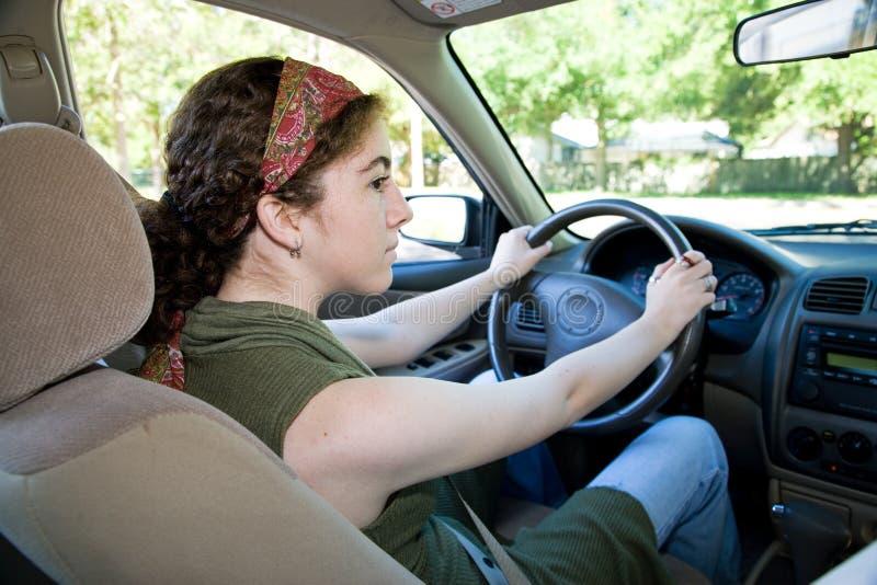 Teen Driver Looks Both Ways royalty free stock photos