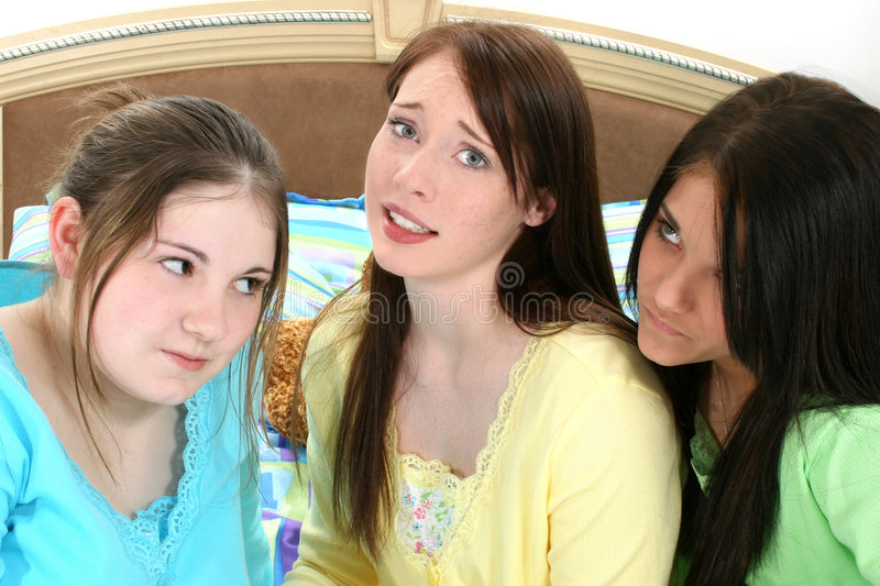 Teen Faces. Three young teens making faces. Wearing pajamas sitting in bed stock photography