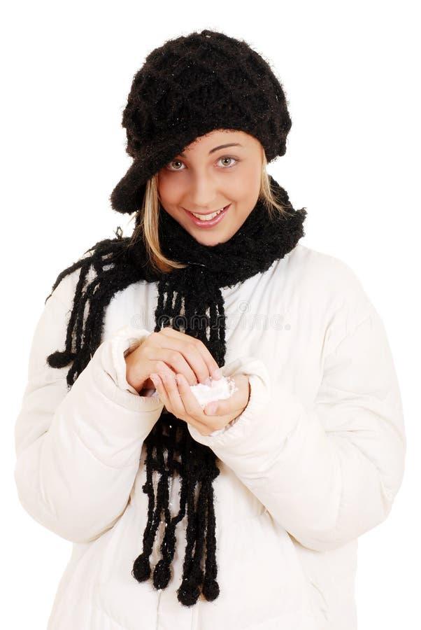 Teen flicka som leker med snow arkivfoto