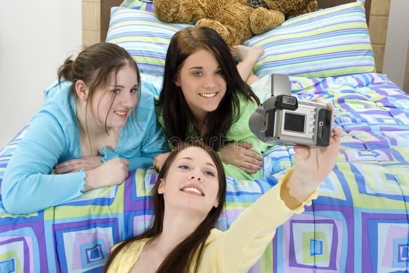 teen flickadeltagareslummer arkivfoto