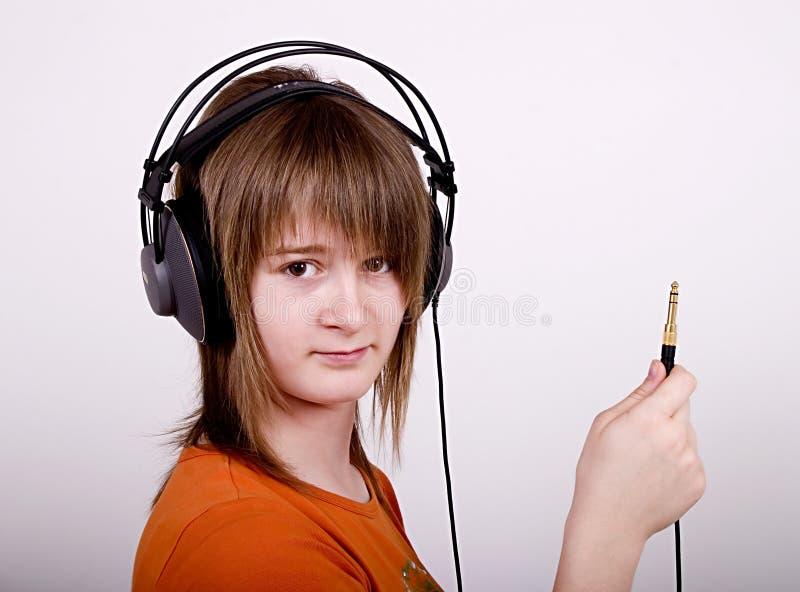 teen flickaheadphone arkivbilder