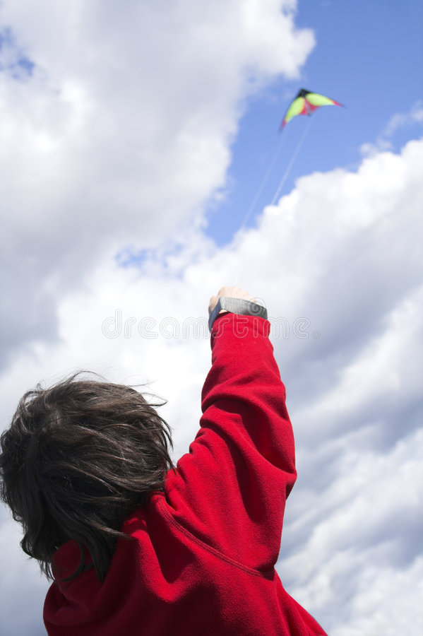 Teen flying kite royalty free stock image