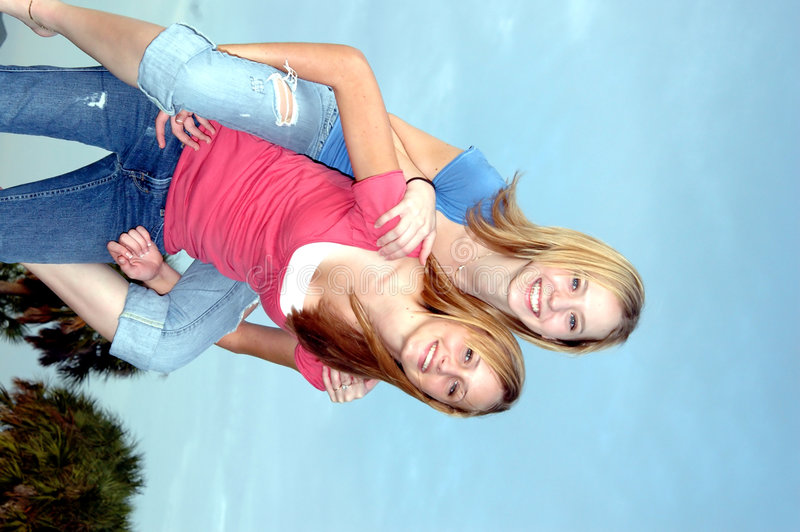 Download Teen friends stock photo. Image of piggyback, embrace - 1378770
