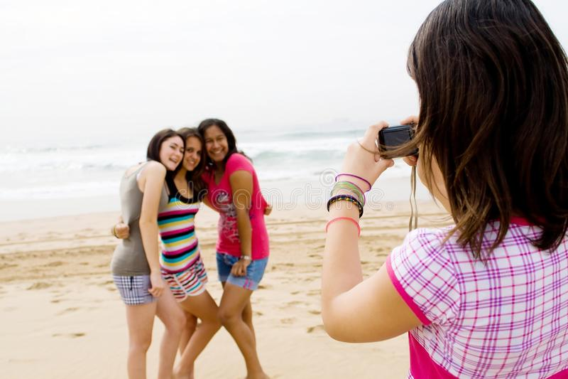 Teen friends taking photos stock photo