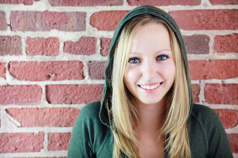 Teen in front of brick wall royalty free stock photography