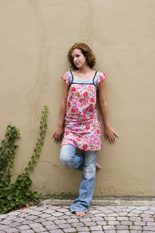 Free Teen Gilr Leaning On Wall Stock Photography - 1388222