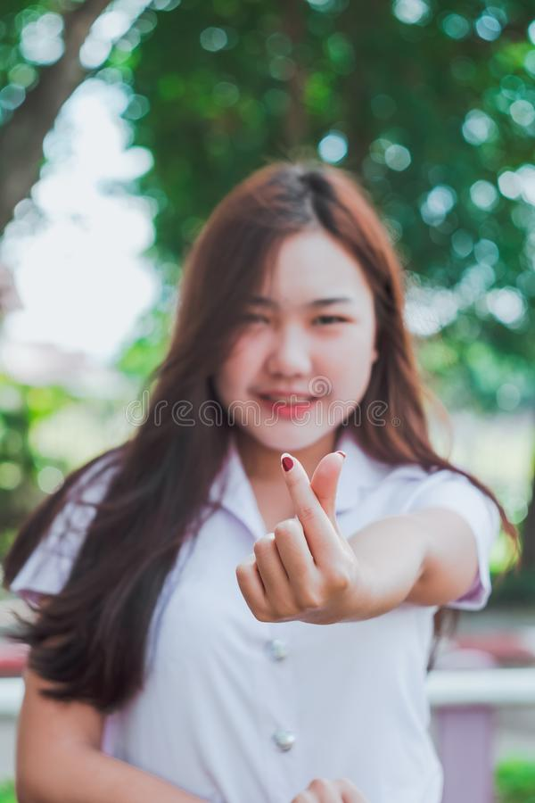 Teen girl action show small heart sign. Concept love royalty free stock photos