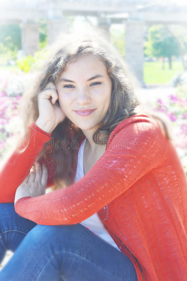 Teen Girl with Blooming Flowers royalty free stock image