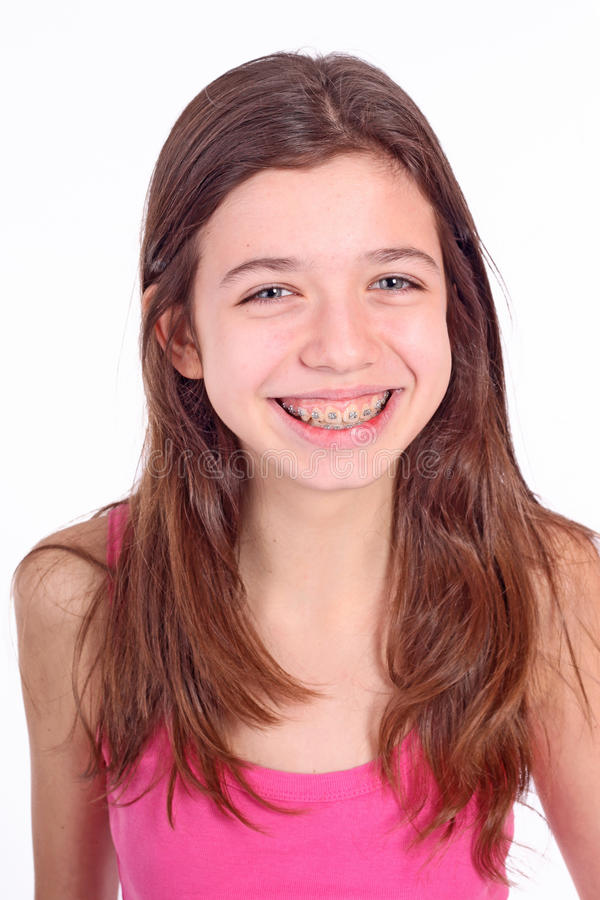 Teen girl with brackets stock images