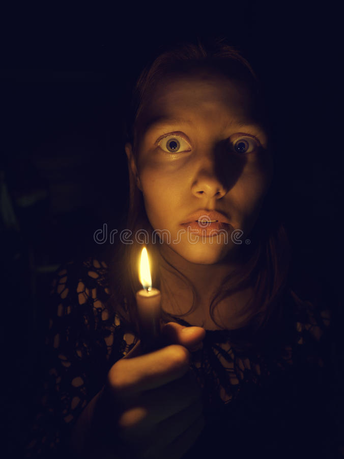 Teen girl with a candle royalty free stock image