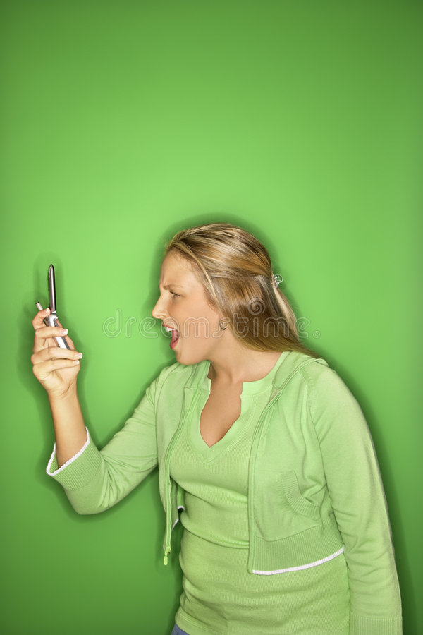 Teen girl with cellphone. stock image