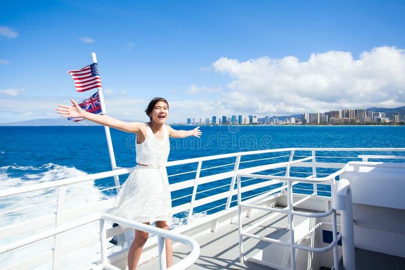 Teen girl on cruise ship in Waikiki bay, Honolulu, Hawaii stock photography