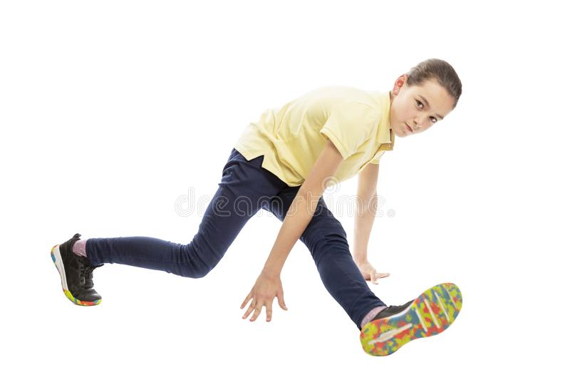 Teen girl dancing break dance. Isolated on a white background. Horizontal royalty free stock photo