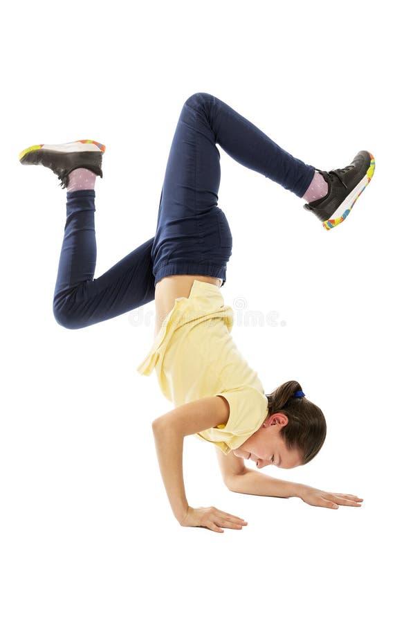 Teen girl dancing break dance. Isolated on a white background. Teen girl dancing break dance. Vertical. Isolated on a white background stock image