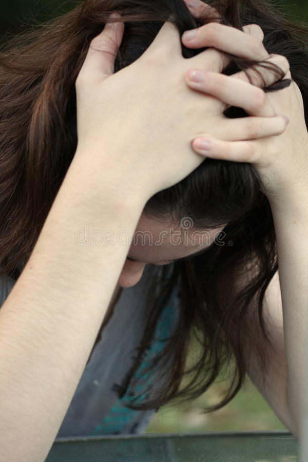 Teen girl depressed stock photography