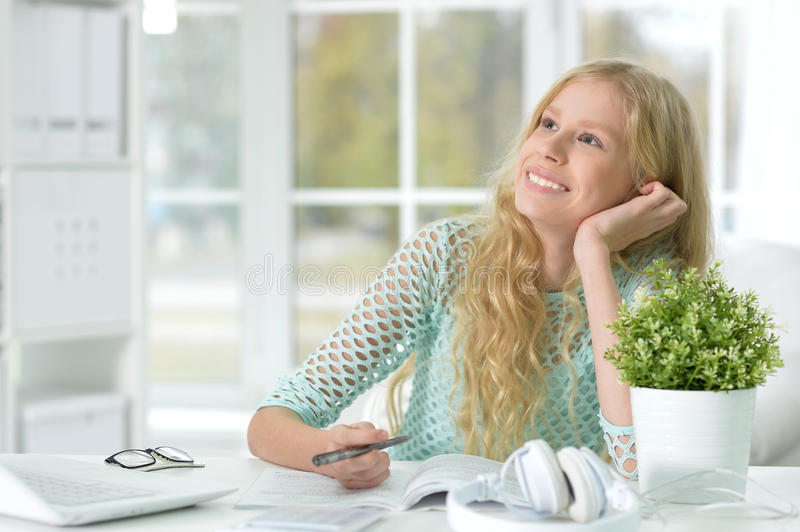 Teen girl doing lessons stock photo