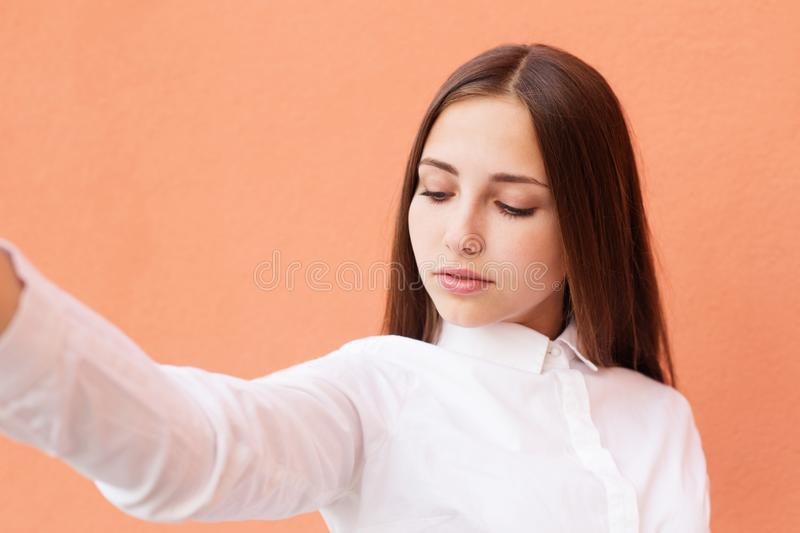Teen girl doing selfie stock photo