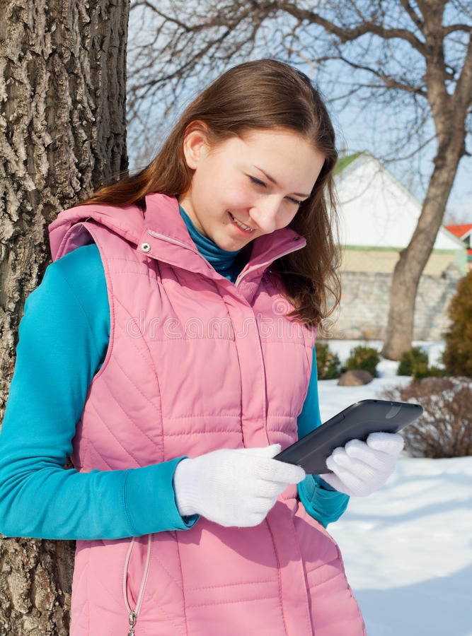Download Teen Girl With E-book Reader In A Park Stock Image - Image: 23920355