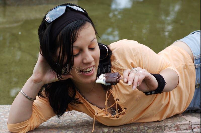 Teen girl eating ice cream royalty free stock photos