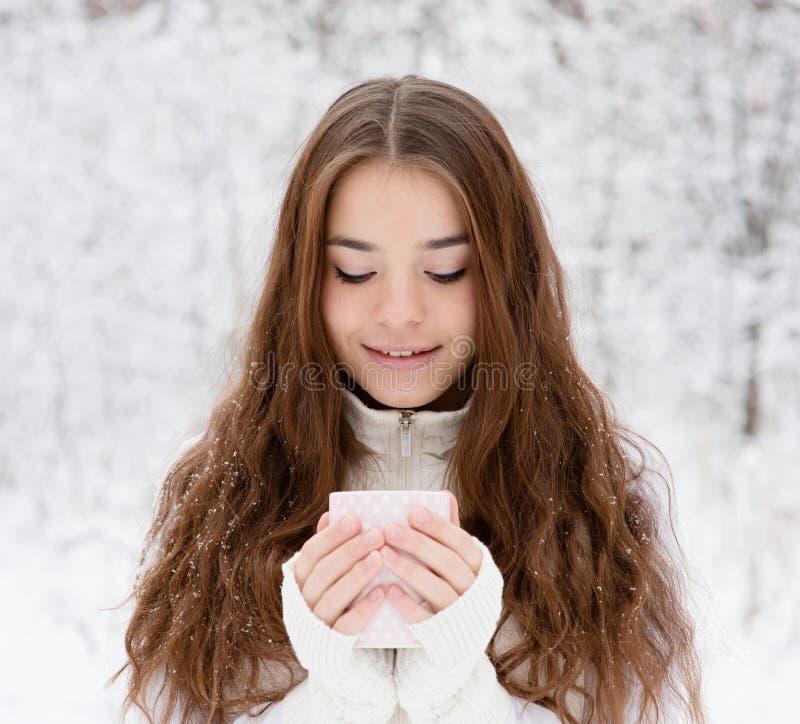 Free Teen Girl Enjoying Big Mug Of Hot Drink During Cold Day Royalty Free Stock Image - 61980226