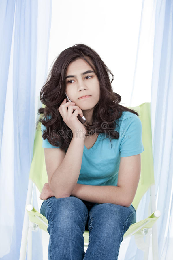 Teen girl girl on stressful phone conversation. Teen girl or young woman having stressful phone conversation stock images