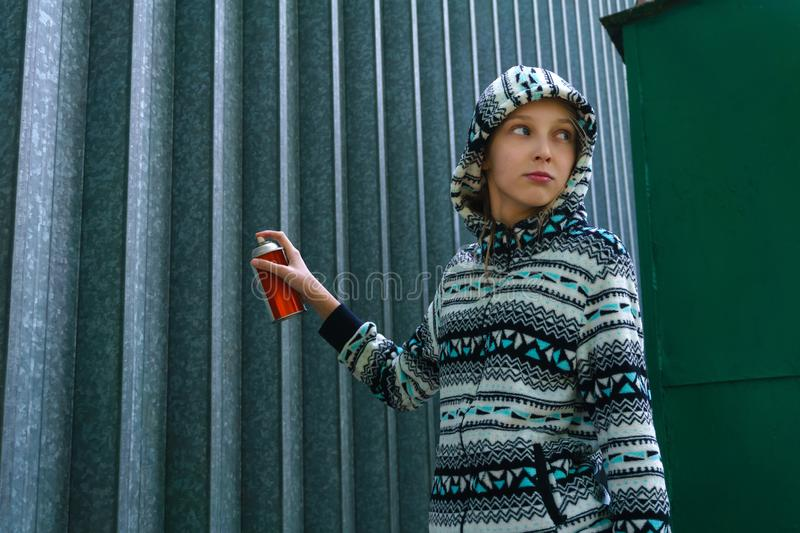 Teen girl going to paint graffiti royalty free stock image