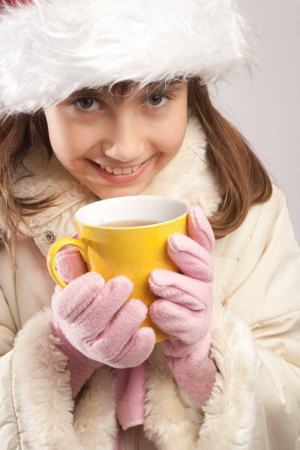 Teen girl having tea stock photography