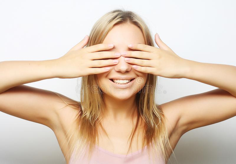 Teen girl with her hands covering her eyes. royalty free stock photography